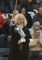 Agnes Varga pumps up the crowd during the celebration of the 1980 St. Peter's Lady Spartans 40th anniversary of winning the state championship.