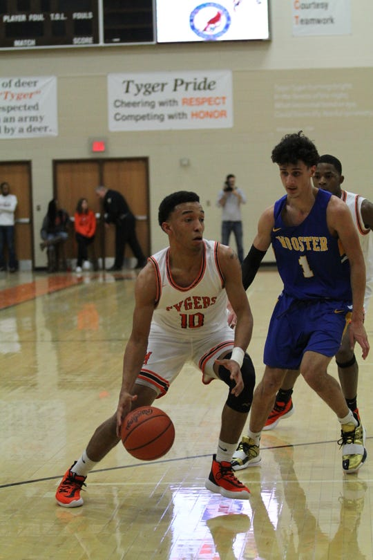 Mansfield Senior's Cameron Todd sank the game-winning 3-pointer in a 51-50 win over Akron Hoban to give the Tygers their first win of the season. Todd scored 12 points in the victory.