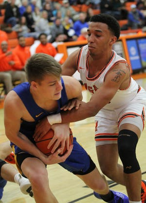 Mansfield Senior's Cam Todd fights for the basketball in Friday's home game with Wooster.