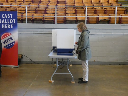 A voter casts her ballot on Nov. 5 at the Veterans Memorial Coliseum polling place. Voter turnout in the 2019 general election was more than a third lower than four years ago in 2015.