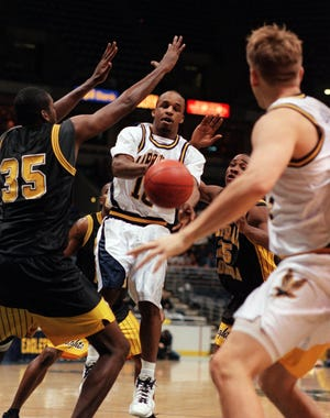 Aaron Hutchins looks to make a pass during his senior season at Marquette in 1997-98.