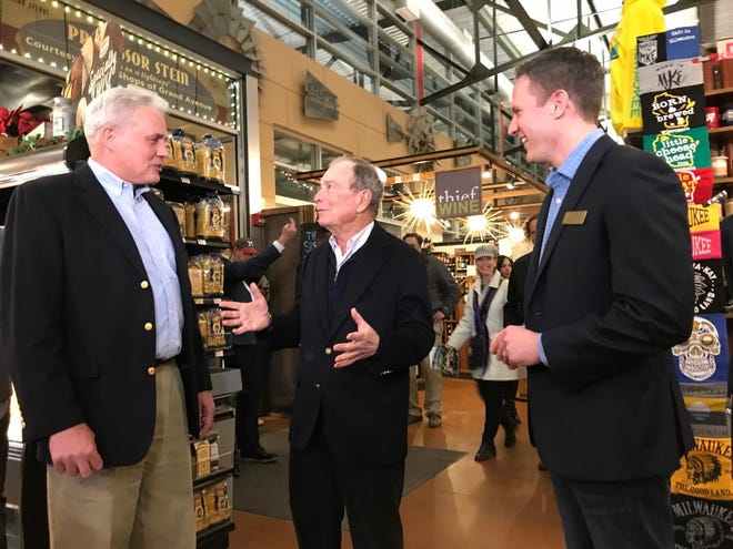 Democratic presidential candidate Michael Bloomberg, center, speaks with Milwaukee Ald. Robert Bauman, left, and Paul Schwartz, executive director of Milwaukee Public Market, while touring the market Saturday. Bloomberg was in the city to open a campaign office.