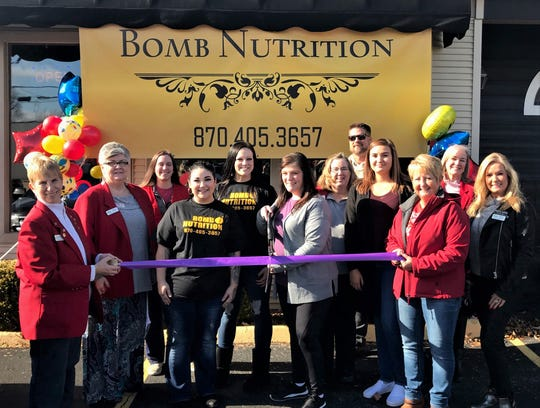 The Mountain Home Area Chamber Commerce recently held a ribbon cutting for the grand opening of Bomb Nutrition, located at 158 S. Main Street in Mountain Home. They offer meal replacement shakes and energizing teas. All of their teas are thermogenic, automatically burning 80 to 100 calories, and are sweetened with stevia. For more information visit their Facebook page, drop by or call (870) 405-3657.