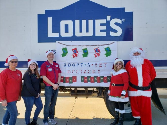 """Lowe's associates would like to give a warm heartfelt """"Thank You"""" to the community for fulfilling the wants and needs of our local veterans in area nursing homes. The response was overwhelming. Packages were delivered on Thursday, Dec. 19 by Santa (Lowe's delivery driver Rick Beals), Mrs. Claus (Pamala Burns with Installed Sales) and their elves (Debbie Miller with Installed Sales, Store Manager Richard Horn and volunteer Jaelynn Swiercz). Lowe's employees wish everyone a merry and blessed Christmas."""