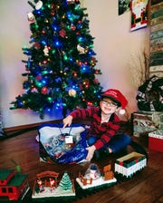 Six-year-old Hayden Lee is shown with some of the Happy Meal toys he recently donated to help brighten the Christmas season for other children.
