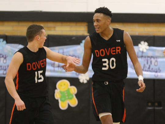 David Hoyt and Rafael Castro of Dover after a basket in the second half of the Dover vs Boonton NJAC-Independence boys basketball game, won by Dover 54-53 on December 21, 2019.