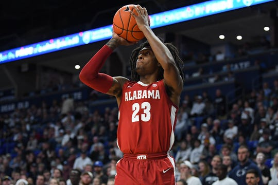 Dec 14, 2019; University Park, PA, USA; Alabama Crimson Tide guard John Petty Jr. (23) shoots the ball against the Penn State Nittany Lions during the second half at the Bryce Jordan Center. Mandatory Credit: Rich Barnes-USA TODAY Sports