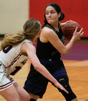 Prattville Christian's Tori DeMaio (5) against Trinity's Maddie Smith (15) in the finals of the Jack Schweers Capital City Classic on the Trinity campus in Montgomery, Ala., on Saturday December 21, 2019.