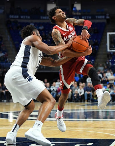 Dec 14, 2019; University Park, PA, USA; Penn State Nittany Lions forward Lamar Stevens (11) attempts to knock the ball away from Alabama Crimson Tide guard James Bolden (11) during the second half at the Bryce Jordan Center. A jump ball would be called on the play. Mandatory Credit: Rich Barnes-USA TODAY Sports