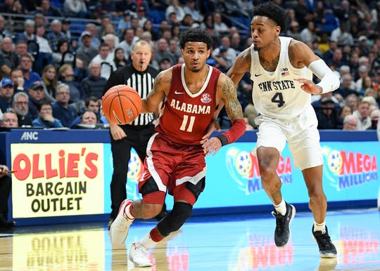Dec 14, 2019; University Park, PA, USA; Alabama Crimson Tide guard James Bolden (11) drives to the basket as Penn State Nittany Lions guard Curtis Jones (4) defends during the second half at the Bryce Jordan Center. Mandatory Credit: Rich Barnes-USA TODAY Sports