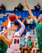 Blackman's Kaylee Odom goes up for a shot as East Hamilton's Madison Hayes defends.