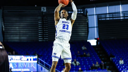 C.J. Jones (23) knocks down one of his six 3-pointers against St. Bonaventure. Jones finished with a season-high 26 points in the Blue Raiders 66-65 loss on December 21, 2019.