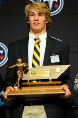 Clay Beathard of Battle Ground Academy accepts his Tennessee Titans Mr. Football Award Monday Dec. 1, 2014, in Murfreesboro, Tenn.