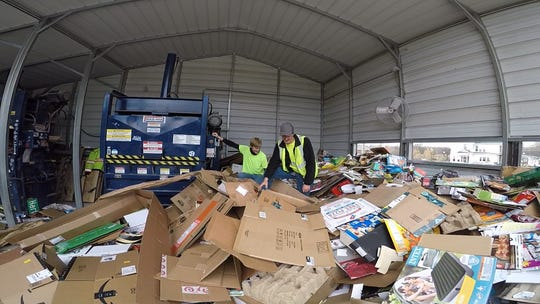 Gallatin Public Works employees sort through overflowing cardboard bins ahead of the Christmas and New Year's holidays.