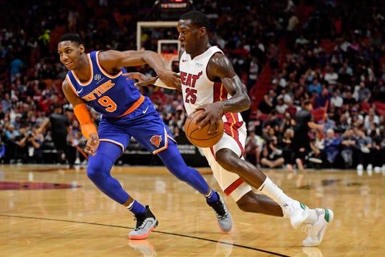 Dec 20, 2019; Miami, Florida, USA;  Miami Heat guard Kendrick Nunn (25) battling New York Knicks forward RJ Barrett (9) for space during the second half at American Airlines Arena.