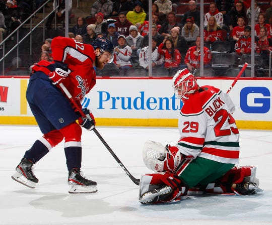 Mackenzie Blackwood #29 of the New Jersey Devils stops a shot by Evgeny Kuznetsov #92 of the Washington Capitals during the first period of an NHL hockey game on Dec. 20, 2019 at  Prudential Center in Newark, New Jersey.