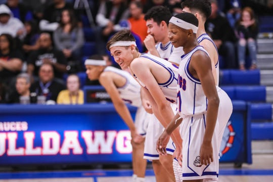The Las Cruces Bulldawgs face off against the Carlsbad Cavemen in Las Cruces on Friday, Dec. 20, 2019.