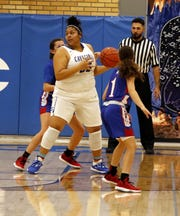 Carlsbad's Kaliyah Montoya posts up against a Las Cruces Lady Bulldawg on Dec. 20, 2019. Montoya finished with 19 points and Carlsbad won, 56-21.