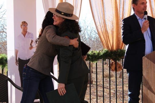 White Sands National Park Superintendent Marie Sauter hugged Congresswoman Xochitl Torres Small (D-N.M.) at an event recognizing the designation of White Sands National Monument into a national park at Heart of the Desert Pistachios & Wine in Alamogordo Saturday, Dec. 21.