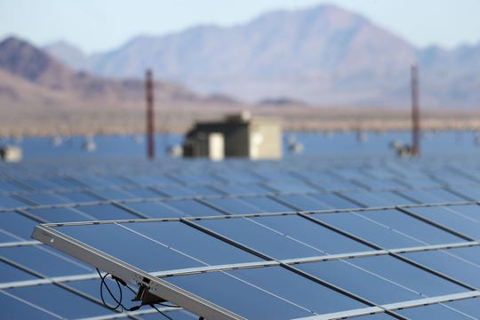 Solar panels harvest the sun's energy at the Desert Sunlight Energy Center near Desert Center,  December 19, 2019.