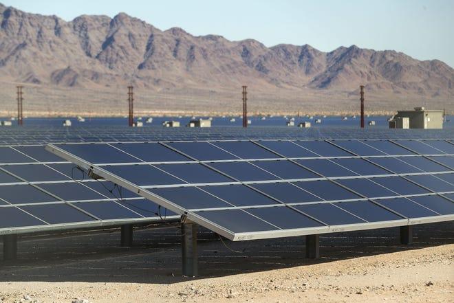 Solar panels produce energy at the Desert Sunlight Energy Center near Desert Center,  December 19, 2019.