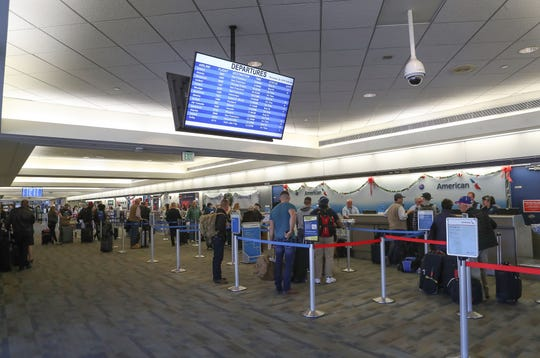 Travelers check-in for their flights at Palm Springs International Airport in an area that will be renovated, December 20, 2019.