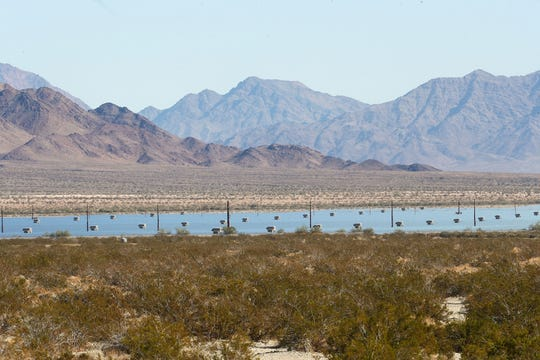 From a distance, thousands of solar panels at Desert Sunlight Energy Center look similar to water near Desert Center,  December 19, 2019.