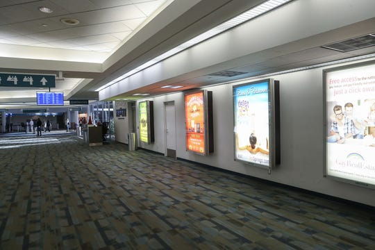 This wall will be taken out and the hallway widened here at Palm Springs International Airport during future renovations, December 6, 2019.
