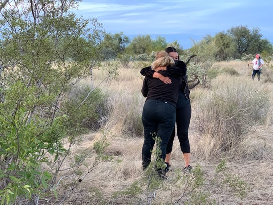 Cecilia Flores, founder of the Searching Mothers of Sonora, collapses into the arms of another volunteers after digging up a body found buried in a remote area west of Hermosillo, Mexico on Dec. 3, 2019.