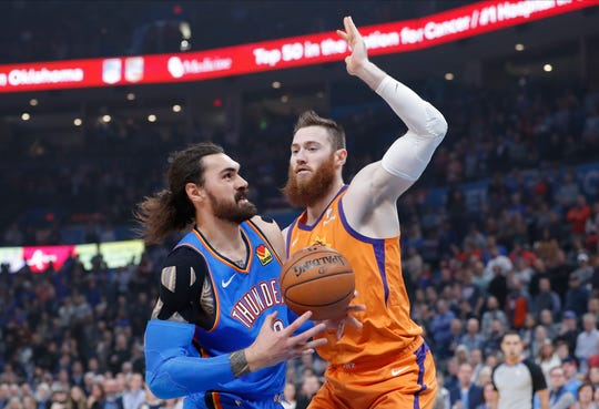 Dec 20, 2019; Oklahoma City, OK, USA; Oklahoma City Thunder center Steven Adams (12) shoots the ball as Phoenix Suns center Aron Baynes (46) defends during the first quarter at Chesapeake Energy Arena. Mandatory Credit: Alonzo Adams-USA TODAY Sports