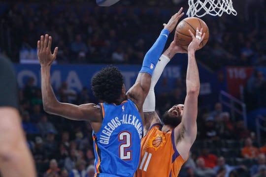 Phoenix Suns guard Ricky Rubio (11) shoots as Oklahoma City Thunder guard Shai Gilgeous-Alexander (2) defends during the second half of an NBA basketball game Friday, Dec. 20, 2019, in Oklahoma City. (AP Photo/Sue Ogrocki)