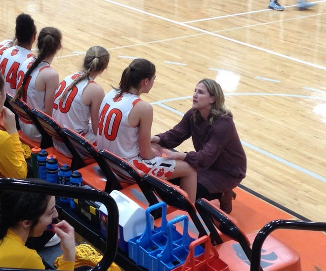 Palmyra coach Mary Manlove talks with Katelyn Becker during a timeout.
