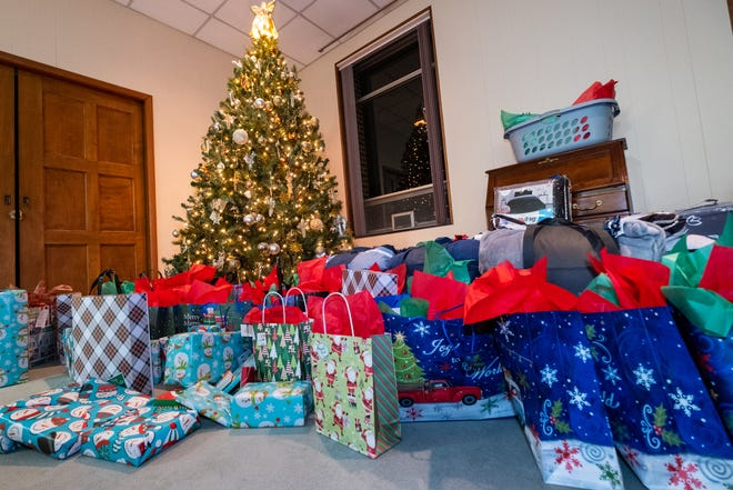 Donated gifts are spread out around a Christmas tree during a Christmas party for Difference Makers Friday, Dec. 20, 2019, at The Center of Port Huron. The gifts were given to families in need adopted by the group.