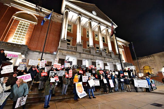 More than 100 activists stand together on the steps of the York County Administrative Center during the Nobody is Above the Law Rally in York City, Tuesday, Dec. 17, 2019. Dawn J. Sagert photo