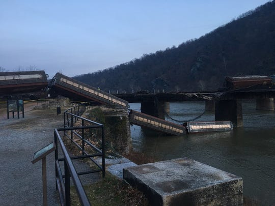 The footbridge attached to the CSX bridge at Harpers Ferry is closed indefinitely after a train derailment on Saturday.