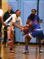 Bishop Kearney's Saniaa Wilson fights for control of the ball with Nottingham's Zyohna Glen.