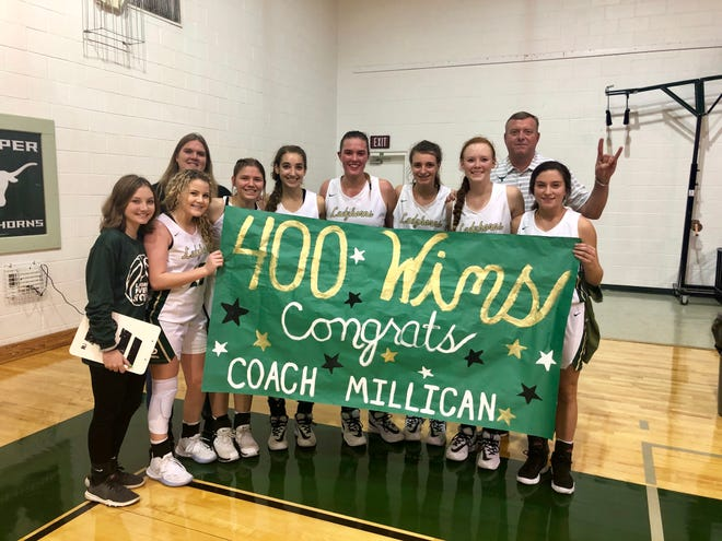 Harper High School girls basketball coach Vance Millican (back row) won his 400th career game on Friday, Dec. 20, 2019.