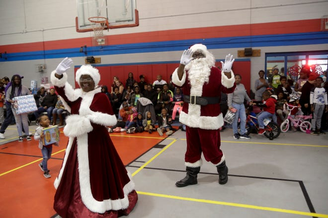 Soul Santa and Mrs. Claus arrive to Walker-Ford Community Center for their annual visit Saturday, Dec. 21, 2019.