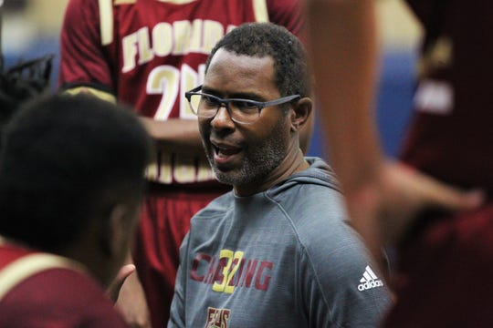 Florida High boys basketball coach Charlie Ward talks to his team during a timeout as the Seminoles beat Plant City during a Capital City Holiday Classic game at TCC's Eagledome on Dec. 21, 2019.