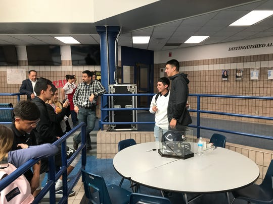Former Del Valle and University of Colorado QB Steven Montez poses for a picture with a Del Valle student during a recent visit to the school. Montez is hoping to get drafted in the 2020 NFL Draft.