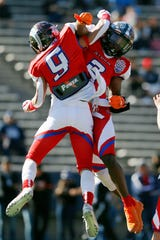 Red Storm's Michael Haack, Franklin, and Isiah Davis, Pebble Hills, celebrate in the end zone after a touchdown during the game against Blue Thunder Saturday, Dec. 21, in the high school football All-Star game at the Sun Bowl in El Paso.
