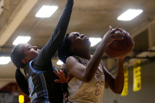 Andress' Tionna Lidge takes a shot against Chapin's defense during the game Friday, Dec. 20, 2019, at Andress High School in El Paso.
