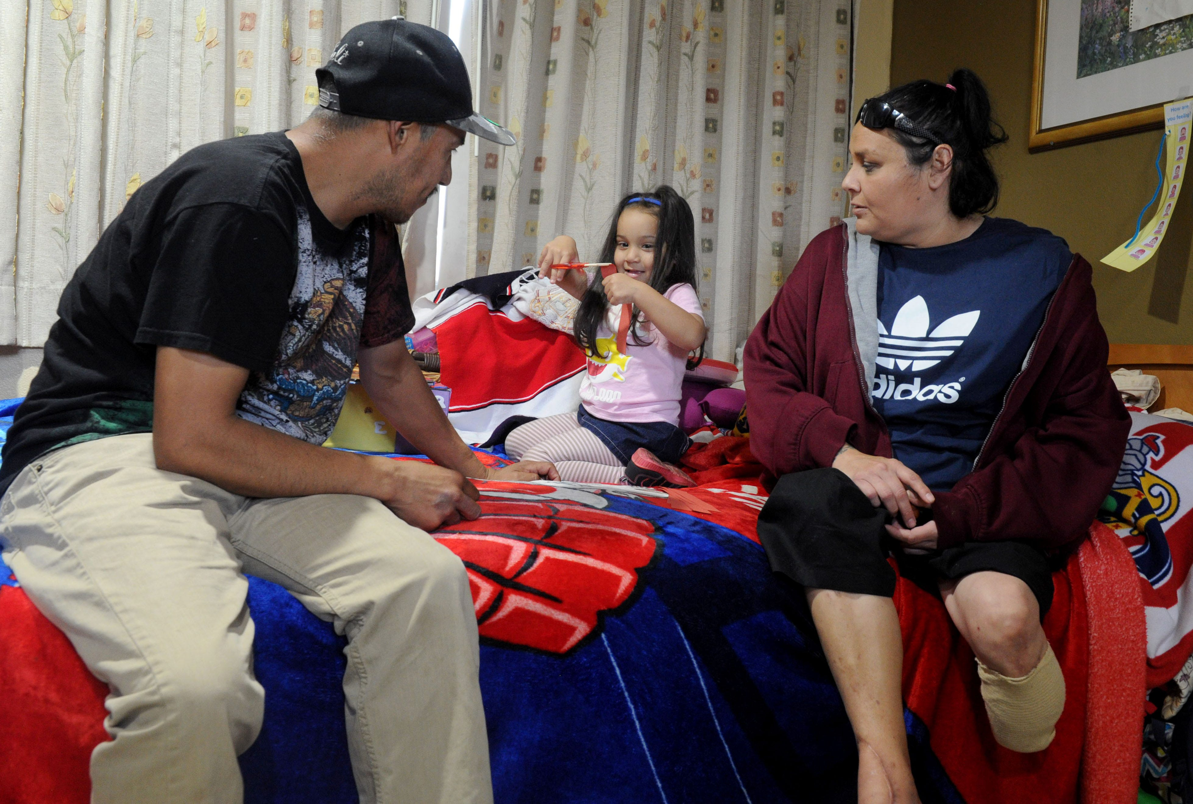 Omar Medina (left), his wife Maria (right) and their children (including Carly, middle) became homeless in August after Maria lost her leg to diabetes and Omar lost his job in the strawberry fields.