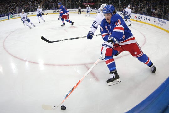 Dec 20, 2019; New York, NY, USA; New York Rangers left wing Brendan Lemieux (48) reaches for the puck in front of Toronto Maple Leafs center Mitch Marner (16) during the second period at Madison Square Garden. Mandatory Credit: Brad Penner-USA TODAY Sports