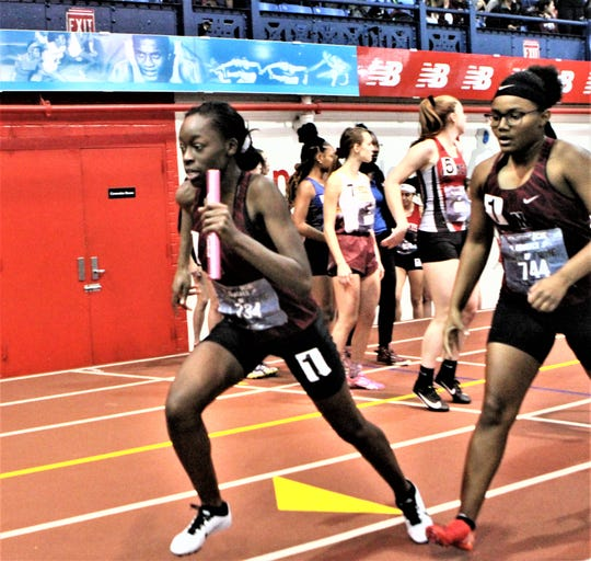 Nyack's Maura Alexander takes off after receiving the baton from Ariana Marsland during Coaches Hall of Fame relay Dec. 21, 2019.