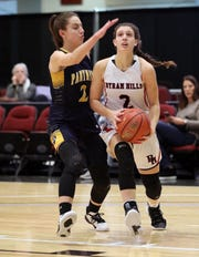Byram Hills' Beth Corelli drives to the basket as Walter Panas' Kristen Cinquina defends during the Slam Dunk Tournament at the Westchester County Center in White Plains, Dec. 21, 2019. Byram Hills beat Walter Panas, 49-44.