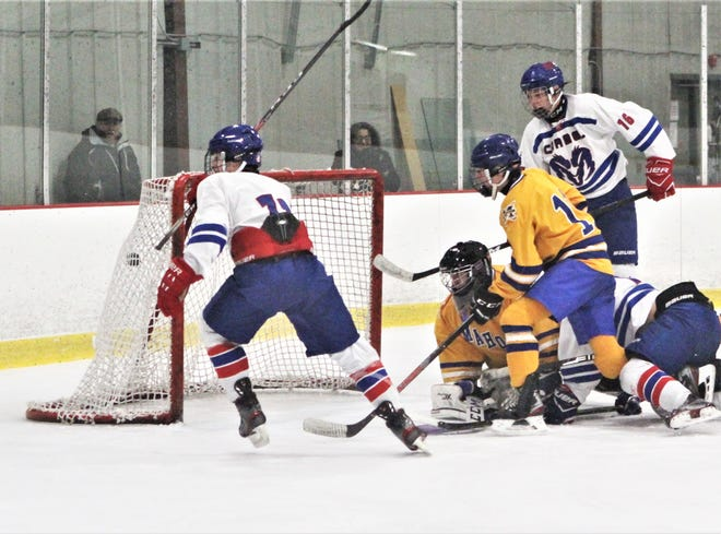 Luke Golisano (l) of Carmel begins to celebrate his third goal as the puck hangs mementarily in the air inside the left post during Carmel's 4-7 win over Mahopac Dec. 20, 2019.