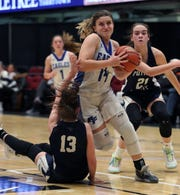 Dobbs Ferry's Kayla Halverson drivers on Putnam Valley's Kelli Venezia during their Slam-Dunk Tournament challenge game at the Westchester County Center Dec. 20, 2019.