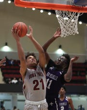 Iona Prep's Dylan Farley (21) works past New Rochelle's Promise Opurum (11) in the opening round of the Slam Dunk Basketball Tournament at the Westchester County Center in White Plains on Saturday, December 21, 2019.