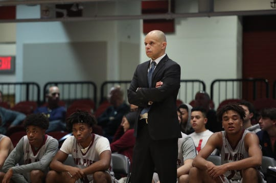Iona Prep head coach Steve Alvarado, Jr. working the sideline in the opening round of the Slam Dunk Basketball Tournament at the Westchester County Center in White Plains on Saturday, December 21, 2019.